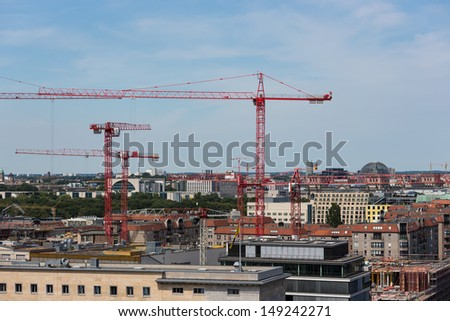 Aerial cityscape of Berlin with construction cranes