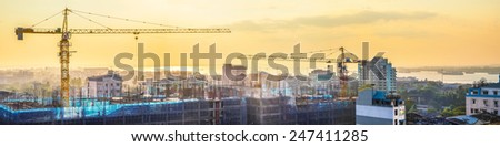 Aerial cityscape panorama view of building construction near the harbor at sunrise. Yangon, Myanmar (Burma) travel landscapes and destinations - stock photo