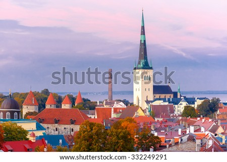 Aerial cityscape with Medieval Old Town and St. Olaf Baptist Church in Tallinn in autumn evening, Estonia - stock photo