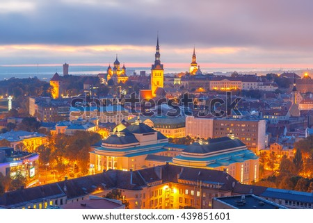 Aerial cityscape with Medieval Old Town illuminated at sunset with Saint Nicholas Church, Cathedral Church of Saint Mary and Alexander Nevsky Cathedral in Tallinn, Estonia - stock photo