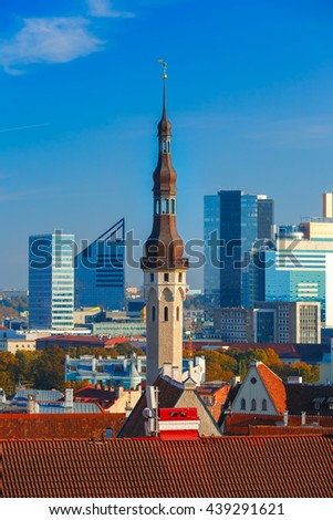 Aerial cityscape with old town hall spire and modern office buildings skyscrapers in the background in Tallinn in the day, Estonia - stock photo
