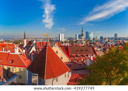 Aerial cityscape with old town hall spire, roofs, Golden Cockerel weather vane and modern office buildings skyscrapers in the background in Tallinn in the day, Estonia - stock photo