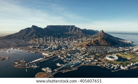 Aerial coastal view of cape town city with table mountain, cape town harbour, lions head and devils peak, South africa. - stock photo
