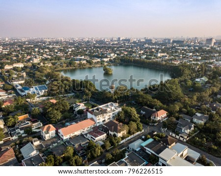 Aerial drone shot, edge of town Cityscape of Bangkok And Nonthaburi Province, in Afternoon to Sunset time, City Background.