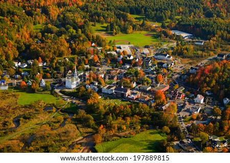 Aerial fall foliage view of rural village, Stowe, Vermont, USA - stock photo