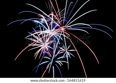 Aerial Fireworks Exploding with Red White and Blue Colors - stock photo