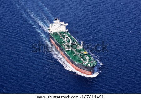 Aerial front view of oil tanker ship on open sea - stock photo