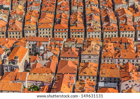 Aerial helicopter shoot of Dubrovnik old town roofs. - stock photo