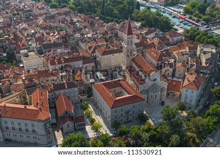 Aerial helicopter shoot of Trogir old town panorama with church in the front. Croatia tourist destination. - stock photo