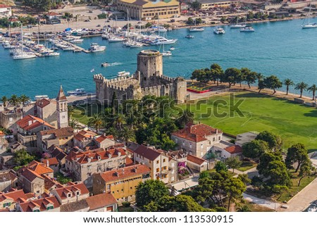 Aerial helicopter shoot of Trogir old town panorama with Kamerlengo Castle. Croatia tourist destination. - stock photo