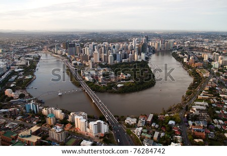 Aerial image of Brisbane at dusk and the Brisbane River meandering through the City, Queensland Australia - stock photo