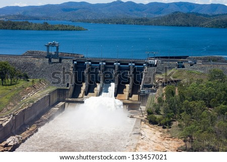 Aerial image of Wivenhoe Dam near Brisbane releasing water from it's spillway. - stock photo