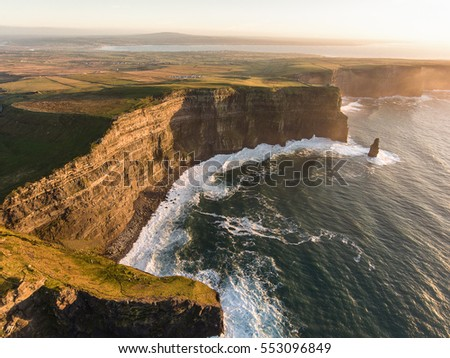 Aerial Ireland countryside tourist attraction in County Clare. The Cliffs of Moher sunset and castle Ireland. Epic Irish Landscape along the wild atlantic way. Beautiful scenic irish nature.