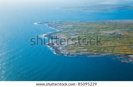 Aerial landscape of the lighthouse on Inisheer Island, part of Aran Islands, Ireland. - stock photo