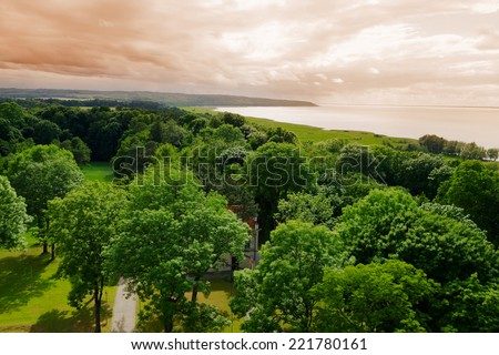 Aerial landscape with view on trees in park and the Vistula Lagoon. Frombork, northern Poland.