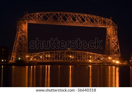 aerial lift bridge in Duluth on Lake superior at night - stock photo