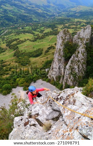 Aerial limestone ridge and woman climbing in fine weather - stock photo