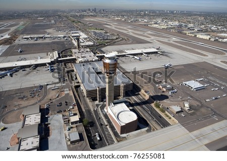 Aerial look at Sky Harbor Airport's tower and terminals in Phoenix, Arizona