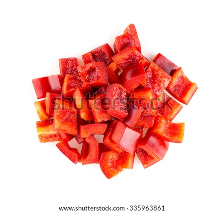 Aerial macro of chopped up red pepper isolated on white - stock photo