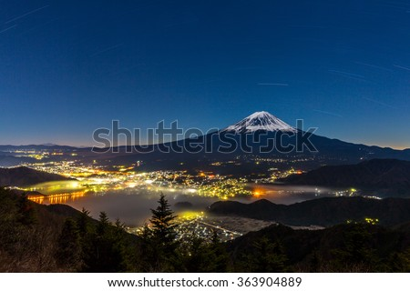 aerial Mount Fuji with kawaguchiko Lake at night - stock photo