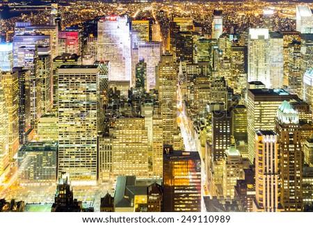 Aerial New York City skyline urban skyscrapers at night, USA. - stock photo