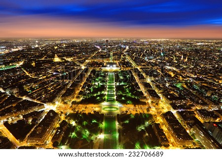 Aerial Night view of Paris City shot on the top of Eiffel Tower - stock photo