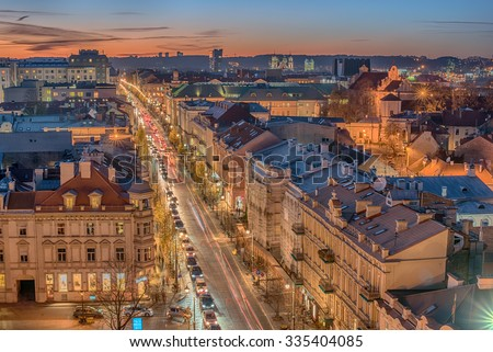 Aerial  night view of the old town and downtown of Vilnius, Lithuania. Gediminas avenue, Gedimino prospektas, the main street. Beautiful representative picture of the Baltic States and Eastern Europe.