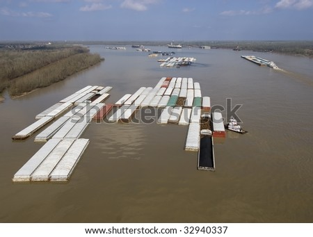 Aerial of barge tow approaching a bend in the Mississippi River - stock photo