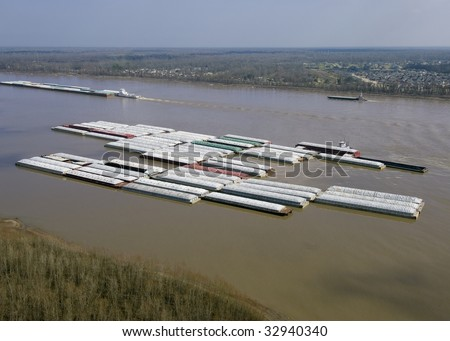 Aerial of barge tow;view across Mississippi River - stock photo