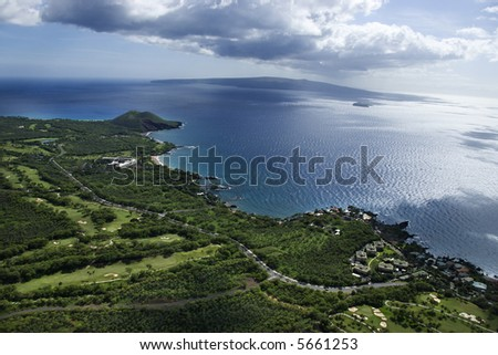 Aerial of coastline with Pacific ocean with island in background in Maui, Hawaii. - stock photo