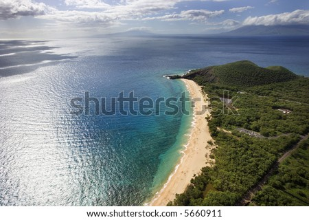 Aerial of coastline with sandy beach and Pacific ocean in Maui, Hawaii. - stock photo