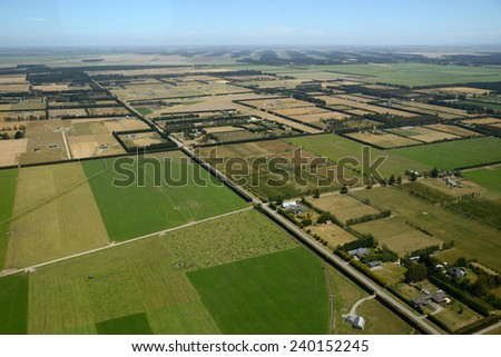 Aerial of dairy and cropping farms in Canterbury, South Island, New Zealand - stock photo