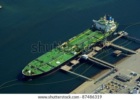 Aerial of green tanker cargo vessel. - stock photo