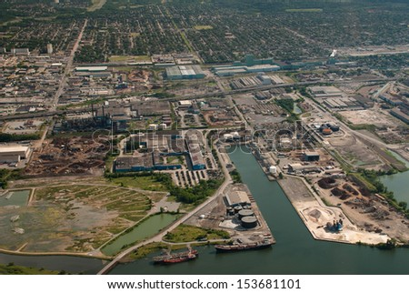 Aerial of industrial harbor and surrounding industry - stock photo