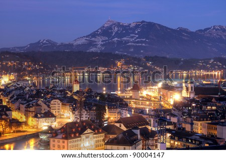 Aerial of Lucerne/Luzern city in central Switzerland in winter/night time with Mont Rigi in the background - stock photo