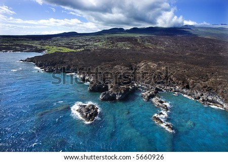 Aerial of Pacific ocean and Maui, Hawaii coast with lava rocks. - stock photo