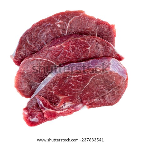 Aerial of raw red meat steaks isolated against a white background - stock photo