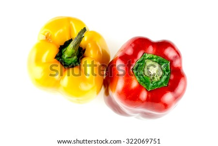 Aerial of spicy red and yellow capsicum peppers - stock photo