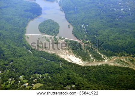 Aerial of the Great Falls National Park on the Potomac River near Washington DC. Below is Great Falls, Virginia, and behind the river is Potomac, Maryland.