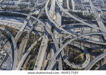 Aerial of the Harbor 110 and Century 105 freeway interchange south of downtown Los Angeles in southern California.