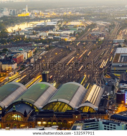 aerial of the Hauptbahnhof in Frankfurt an Main  in the evening - stock photo
