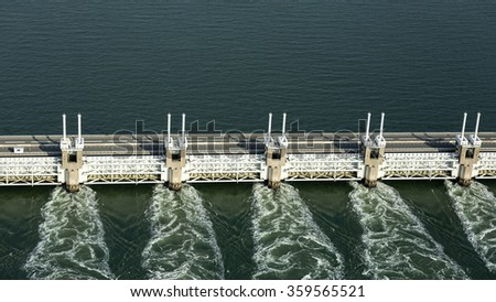 Aerial of the Oosterscheldekering, a storm surge barrier which is part of the delta works to protect Holland from high sea level - stock photo