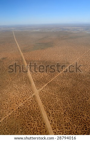 Aerial of two roads crossing in the desert in Texas - stock photo