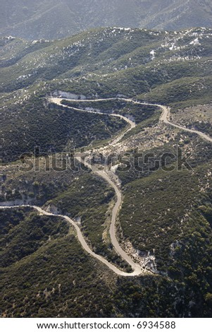 Aerial of winding scenic road in California, USA.