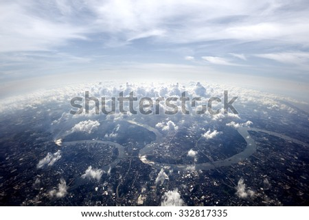Aerial overview Bangkok cityscape.Town scenery above the clouds - stock photo