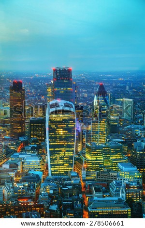 Aerial overview of the City of London financial ddistrict at night - stock photo