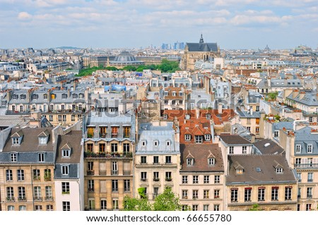 Aerial panorama above houses rooftops in a Paris - stock photo