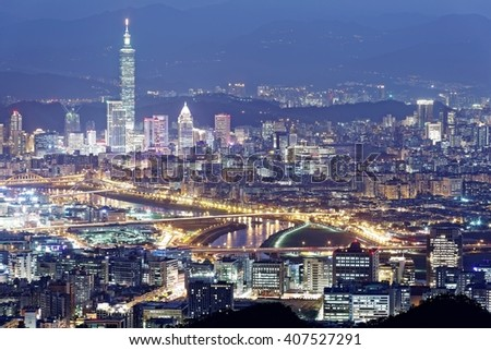Aerial panorama of busy Taipei City at night with view of prominent Taipei 101 Tower in downtown & bridges across Keelung River ~ A romantic evening of Taipei, in beautiful mood of blue twilight