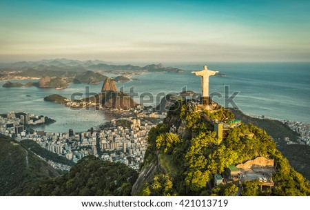 Aerial panorama of Christ and Sugar Loaf Mountain, Rio De Janeiro, Brazil. Vintage colors - stock photo