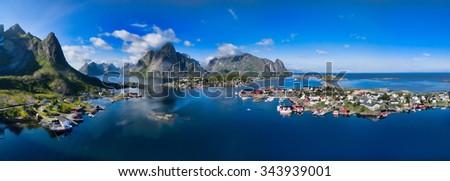 Aerial panorama of Reine, scenic fishing town on Lofoten islands in Norway - stock photo